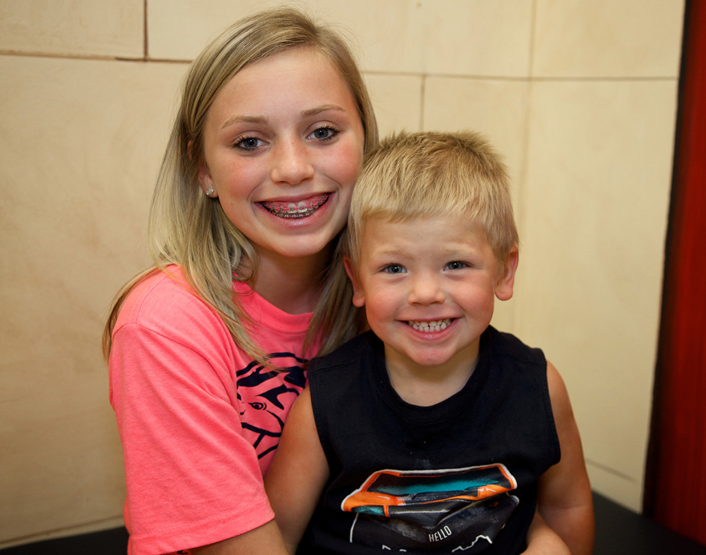 Dawsonville Family Orthodontics patient with braces and little brother