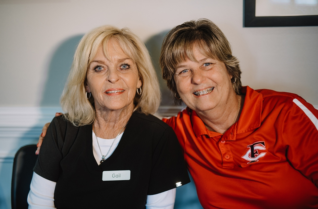 Sandy Springs Orthodontic staff and adult braces patient