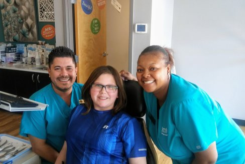 braces on patient with staff smiling